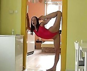 Contortionist babe fucks wall dildo