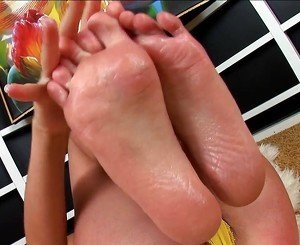 sexy blond lotions up her feet and masturbates