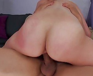 Brunette with a round booty doing splits on a cock