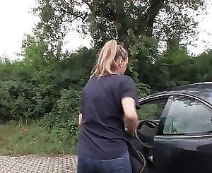 Anxious blonde sucking cock outdoors, near her car