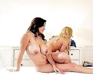 Lusty lesbian pussy-eaters 69-ing on a huge white massage table