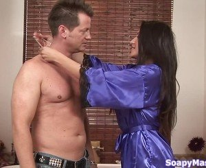 Blue robe brunette jerking this dude's massive cock